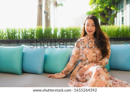 Portrait beautiful young asian women happy smile sit on sofa around outdoor view