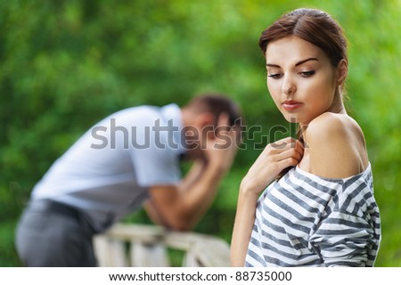 portrait beautiful young couple man woman quarreled background summer green park
