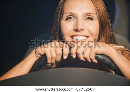 portrait beautiful young hands wheel smiling