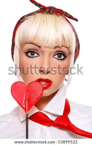 Portrait beautiful young sexy blond girl with red lollipop heart in hand