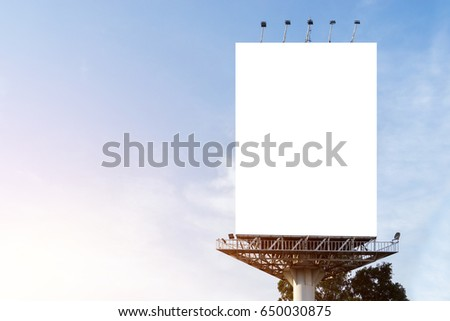 Portrait billboard blank for outdoor advertising poster at sunset blue sky.