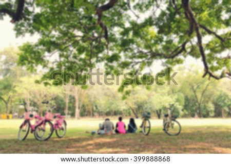 portrait blur of friends with bike in the park. - Shutterstock ID 399888868