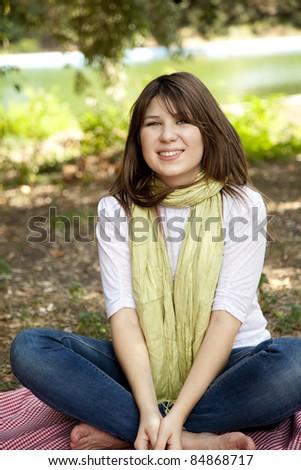 Portrait brunette girl at outdoor. Autumn. #84868717