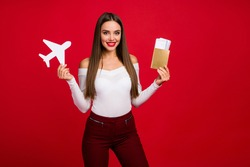 Portrait charming fascinating charming lady hold wite paper card plane tickets enjoy reach summer weekend destination wear checkered white trousers isolated bright shine color background