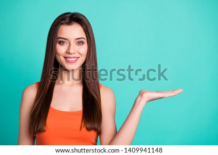 Portrait charming people millennial positive cheerful satisfied ad advertisement decision suggest present information sales discount news tip promoter concept modern clothing isolated green background