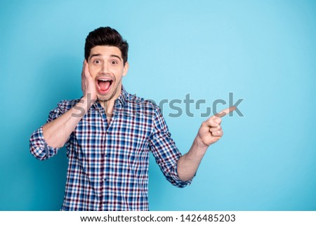 Portrait cheerful content youngster touch face stubble hand scream astonished impressed incredible novelty promo adverts choice decision tip suggest present plaid outfit isolated blue background