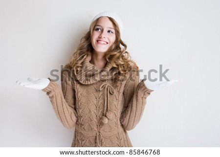 Portrait cheerful gesturing winter fashion girl.
