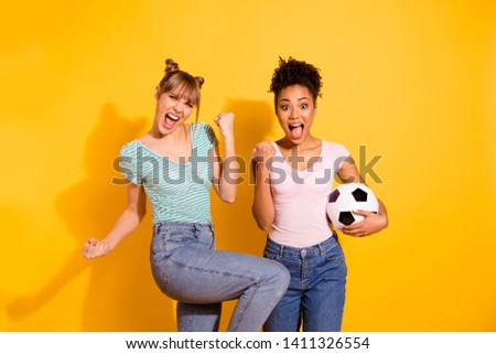 Portrait cheerful student hold hand energy achieve beautiful bun excited scream goal success sporty luck raise fists wavy curly jeans top-knot trendy style stylish t-shirt isolated yellow background #1411326554