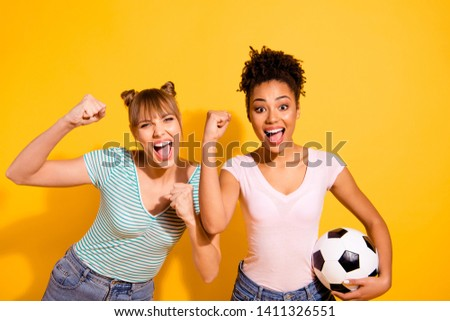 Portrait cheerful student hold hand raise fists beautiful bun energy achieve scream yes goal victory champions wavy curly hairdo top-knot trendy style stylish t-shirt isolated yellow background