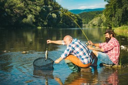 Portrait cheerful two bearded men fishing. Fishing is fun. Home of hobbies. Happy fly fishing. Summer weekends or vacation. Luxury life concept. Active sunny day. Happy cheerful people. Trout bait
