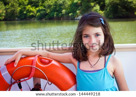Portrait child ,happy girl on boat with red life-belt