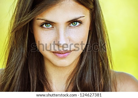 Portrait close up of young beautiful woman, on green background summer nature. #124627381