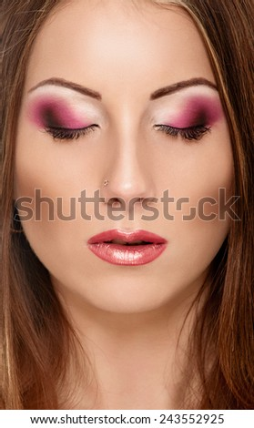 Portrait close up of young beautiful woman with closed eyes #243552925