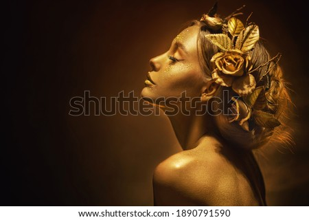 Portrait Closeup Beauty fantasy woman, face in gold paint. Golden shiny skin. Fashion model girl, image goddess. Glamorous crown, wreath roses, jewellery accessories. Professional metallic makeup. Сток-фото ©