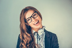 Portrait closeup of funny, excited joyful female, laughing business woman smiling girl wearing glasses looking at you isolated green background wall. Positive human emotion facial expression attitude