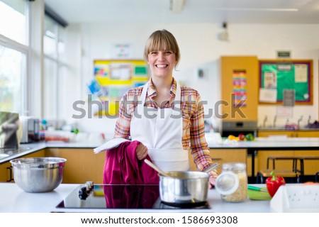 Portrait confident home economics teacher