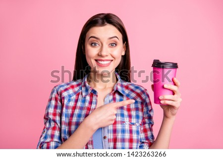 Portrait cute charming millennial promoter hold hand beverage mug dream dreamy advise decision choice suggest tip demonstrate adverts sales rest free time modern clothing isolated pink background