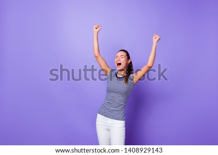 Portrait cute charming sweet lady youth close yes raise fists true sport fan have get aim achievements successful shout yeah excited amazed spring summer clothes isolated vibrant violet background