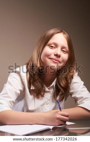 Portrait cute smiling teen schoolgirl #177342026