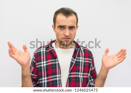 Portrait, disappointed, guy in casual clothes, gesticulating hands, looking at camera, white background, front view