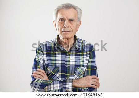 Portrait elderly man on gray background #601648163