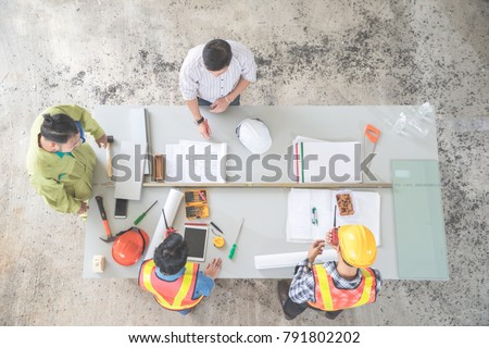 portrait engineer people working and discussing with architecture at construction site, using as background (concept of teamwork and partnership)