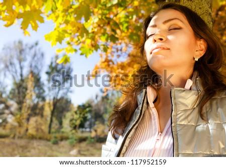 Portrait enjoyed beautiful asian girl at the autumn park