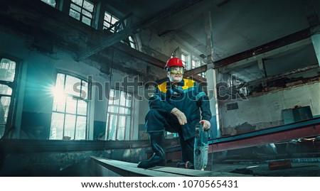 Portrait factory senior welder worker on manufacture workshop background