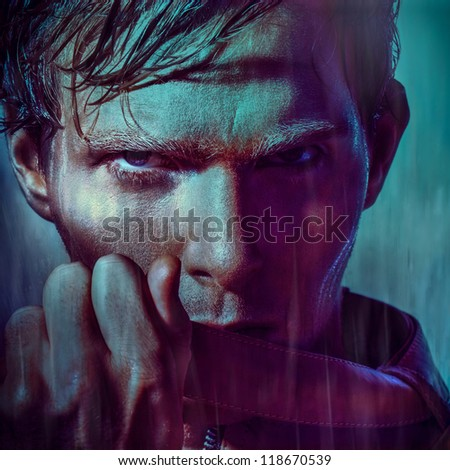 portrait fashion model man before rain with wet hair and face