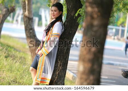 Portrait fashion of Asian female graduate in Thailand
