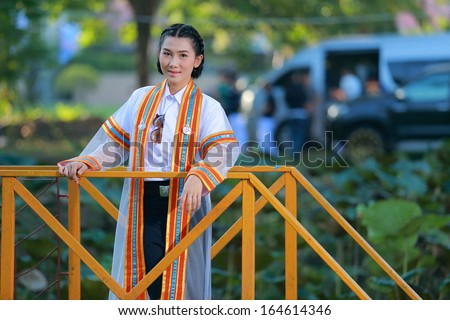 Portrait fashion of Asian female graduate in Thailand