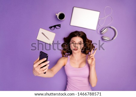 Portrait foxy teen device online browse internet  send air kiss make v-sign tank-top singlet stylish pause hairstyle hipster trendy development work worker wavy curly isolated purple violet background #1466788571