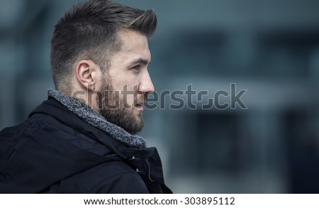 Portrait from an attractive man with a beard