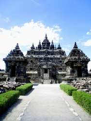 Portrait front view shot of Plaosan Temple Candi, Klaten, Central Java, Indonesia with rocks ruins beside. A Javanese historical landmark, Buddhist temple with stone walls and gates