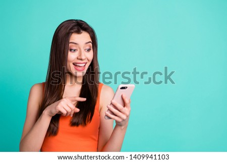 Portrait funny funky teen advertise advice advise choose decide scream unbelievable unexpected hold hand gadget vidget use apps cheerful chat long hairdo orange clothing isolated turquoise background