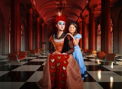 Portrait girl in costume Red Queen and little girl in a blue dress in the Hall of Columns