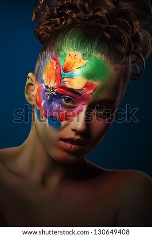 Portrait girl with body painted flower face