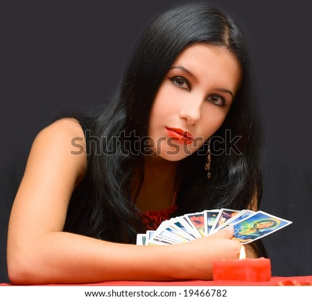 Portrait girl with cards on black background