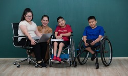 Portrait group of special kids classroom, disable and down syndrome boys, girl and teacher taking photo together with happiness and intimate pose.