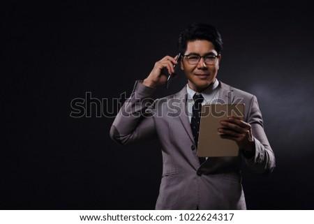 b4526e782cb7 Portrait Half body, Business Man Stand gray Suit white shirt black pants  shoes, studio