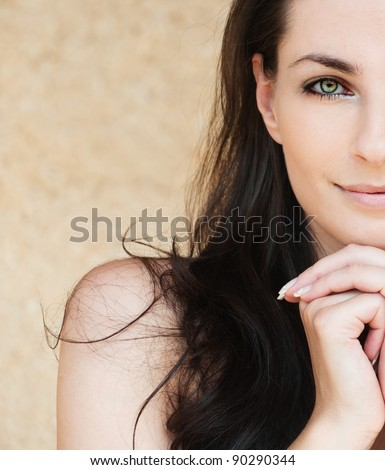 portrait half of face lovely woman smiling dark-haired bare shoulders