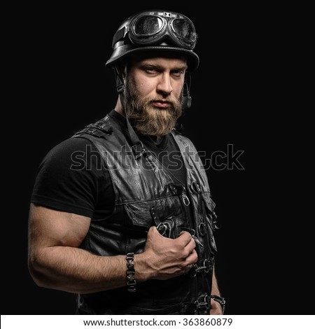 Portrait Handsome Bearded Biker Man in Leather Jacket and Helmet over Black Background