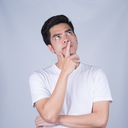 Portrait handsome young asian man wearing a white T-shirt thinking and stress isolated on whitel  background.Asia man people. business concept.Copy space.