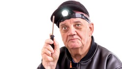 Portrait handyman man with screwdriver in hand and headlamp on
