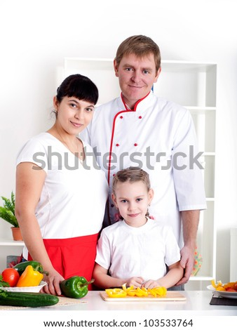 portrait happy family is cooking dinner together