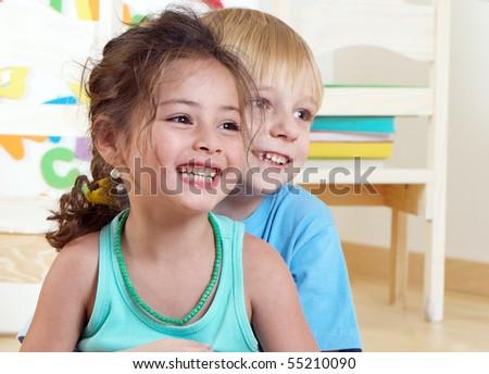 Portrait happy kids in kindergarten
