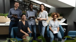Portrait happy smiling diverse employees team in modern office, successful workers looking at camera, posing for corporate photo, professionals group motivated for business success
