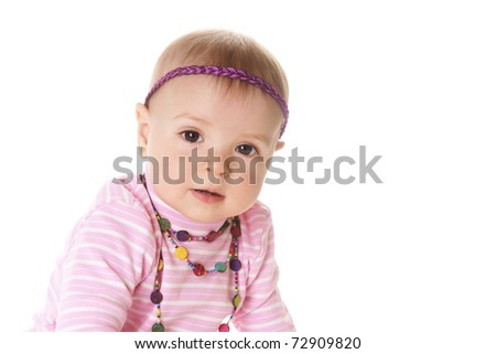 Portrait if beautiful baby girl in pink sweater isolated on white background