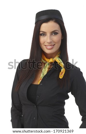 Portrait if pretty young stewardess with long hair wearing hat, smiling, looking at camera.
