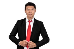 Portrait image of Asian business man wearing black suit standing and smile On white isolated background, to people and business concept